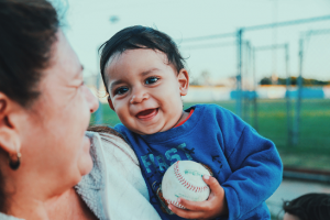 Sharing a smile with a baby. Epiphany Life Coaching